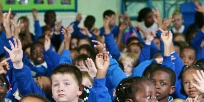 Barnabas in Schools Children raising their hands