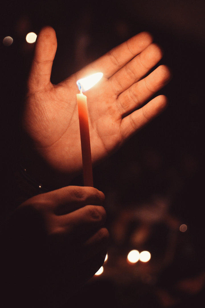 Hand near a candle