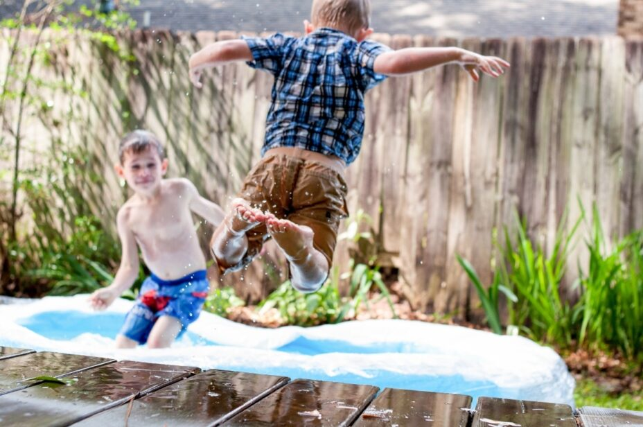 Two young boys in a paddling pool
