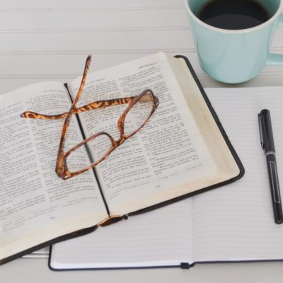 Pen, books, glasses and cup of coffee