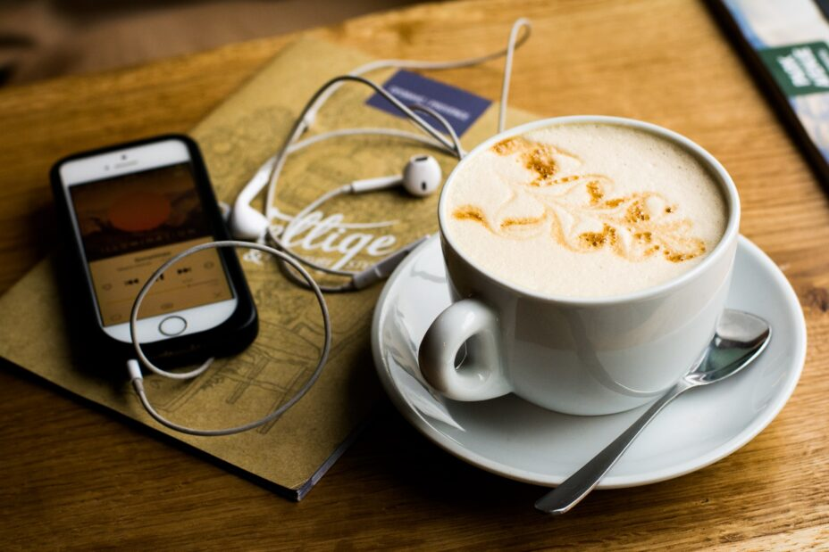 Reading with a phone and a cup of coffee