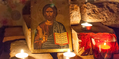 Prayer space with candles and icon of Jesus