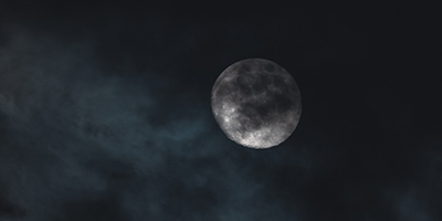Full moon shrouded in clouds