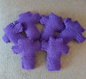 seven purple knitted crosses
