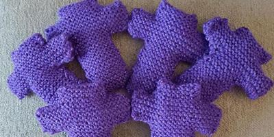 Purple knitted crosses