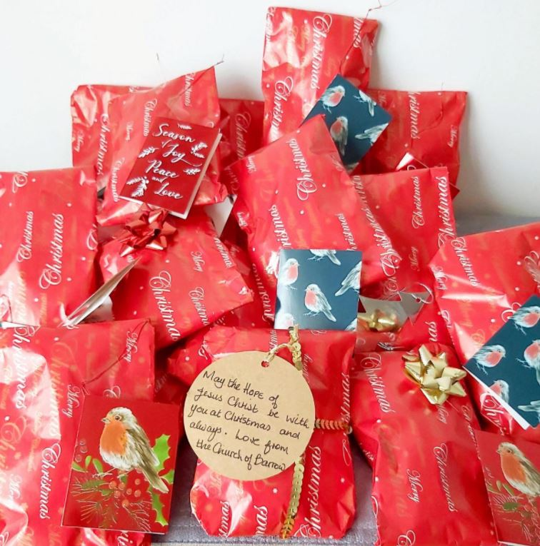 Collection of wrapped knitted crosses with gift tags