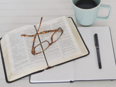 Bible, pen and glasses