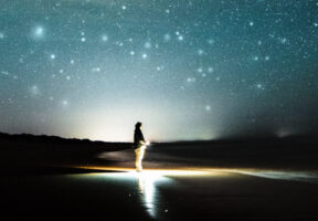 A person looking up at the night sky