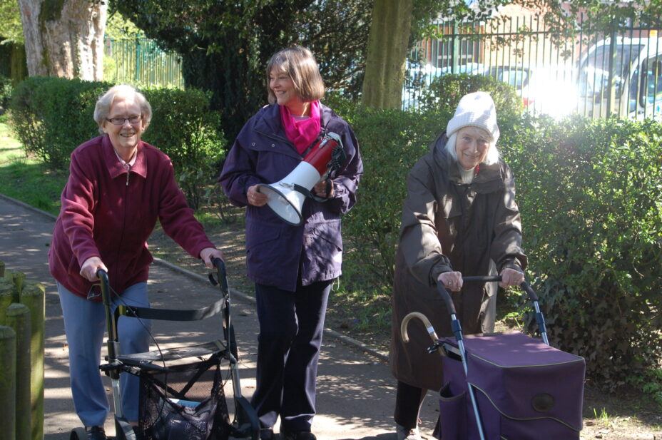 BRF's Anna Chaplaincy Pioneer with two older ladies using walking frames on an Anna Chaplaincy sponsored walk