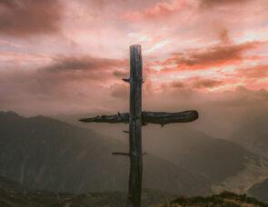 A wooden cross overlooking mountains