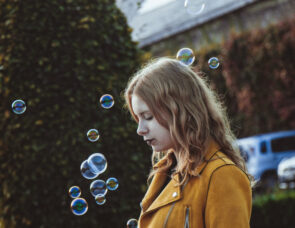 A child playing with bubbles