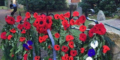 Church gate decorated with knitted poppies