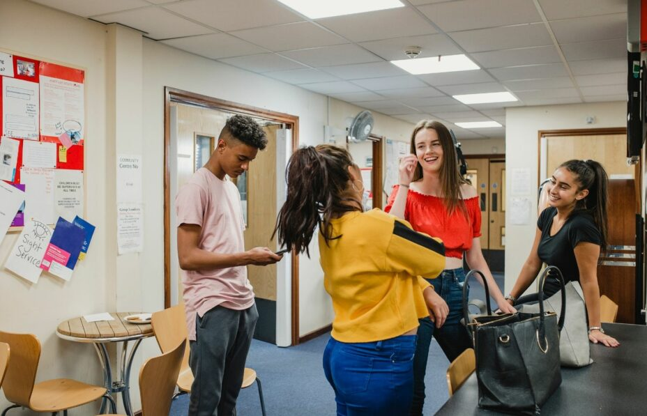 Group of teenagers chatting in a school corridor