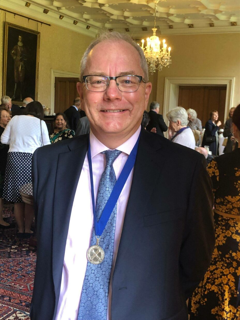 Richard Fisher, BRF's CEO, wearing his medal